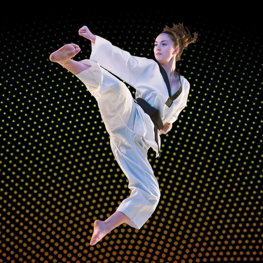 Martial Arts Lessons for Adults in Naperville IL - Girl Black Belt Jumping High Kick